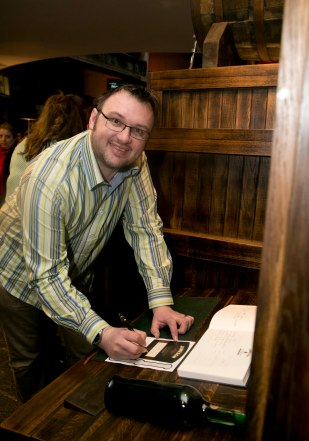 Stewart at Jameson, signing the ledger